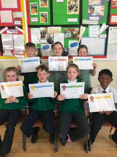 Pictured with their certificates for attending Numeracy Club are: Caoimhin, Grace, Feanna, Amy, Caolan, Kelsy and Steive.