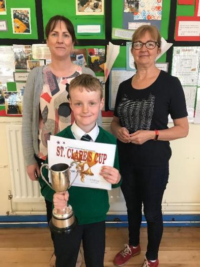 The St. Clare's Cup (Spirit of School, using talents, community participation) in Key Stage 1 was presented to Aaron. Absent from photo is nominee Mollie.