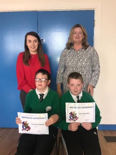 Tiernan and Dara pictured with their certificates for Improved Numeracy.