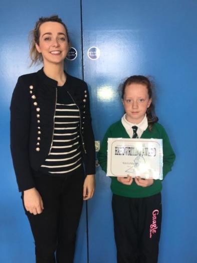 Miss Hughes and Nikita pictured with her Handwriting Award.