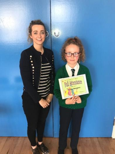 Caitlin was presented with a certificate for Full Attendance by her teacher Miss Hughes.