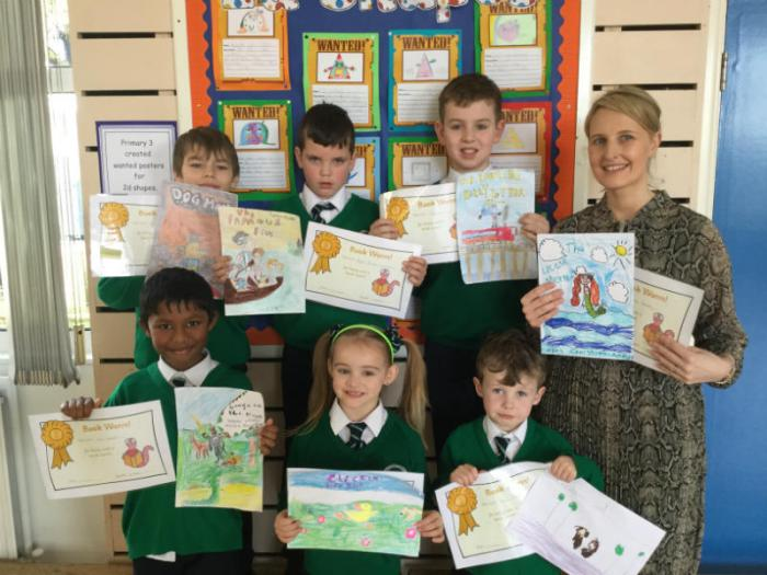 Our poster competition winners James, Casey-Leigh, Eoghan Ruadh, Steive, Emils and Peter. Also pictured is Mrs Donaghy P1 teacher, with Grace's poster.